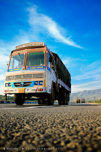 A low angle view of an ongoing truck in bangalore - salem highway