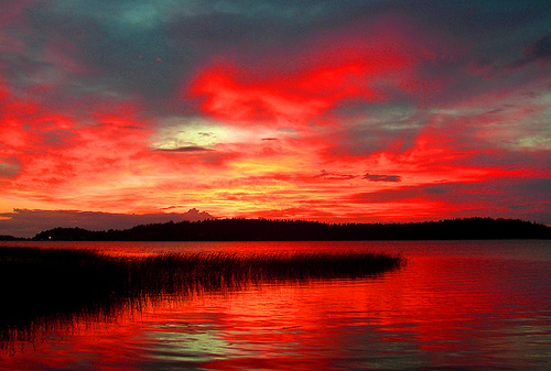 Burning sky - deep red sunset reflected in lake