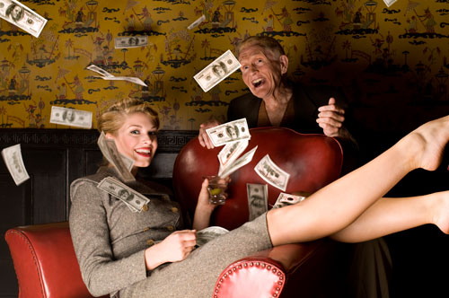 Stock Photo of Woman Throwing Money in Air with Senior Man