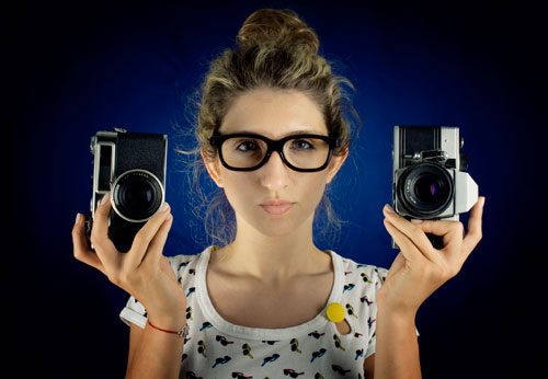 Stock Photo of woman with cameras from iStock