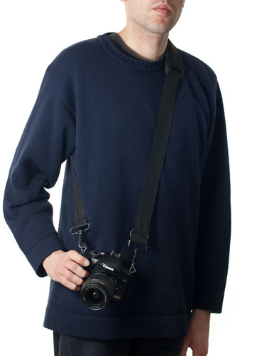 Camera on strap that goes round neck and under one arm