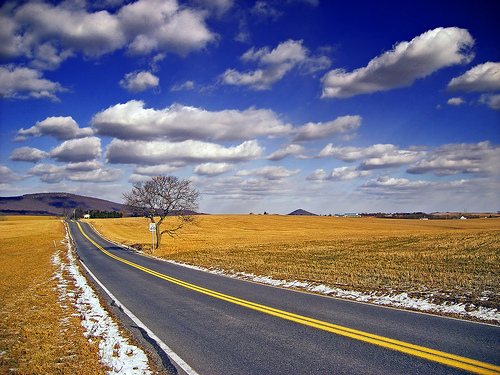 Landscape photo with converging lines of a road used as compositional element