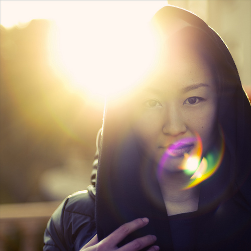 Creative use of lens flare in a portrait photo
