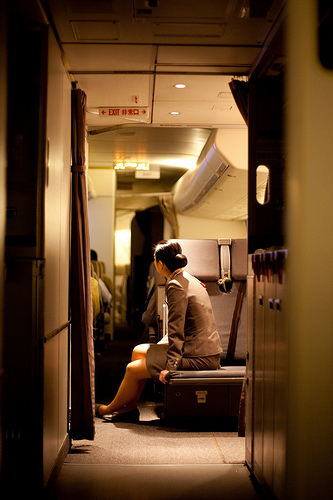 Photo of flight attendant taken using a large aperture in low light
