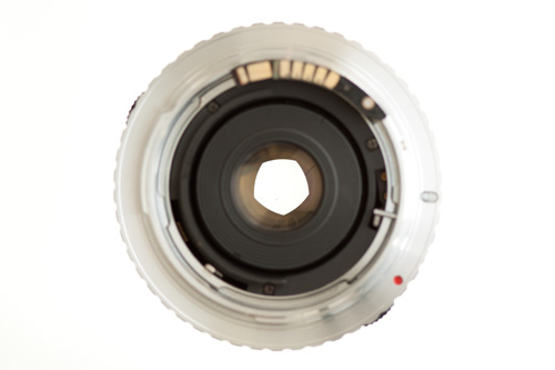 Lens with aperture partially closed