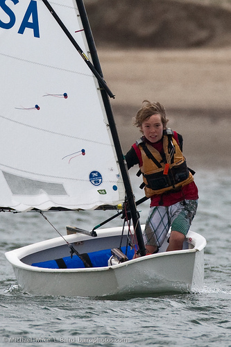 Boy in sailboat race photographed using a super telephoto focal length