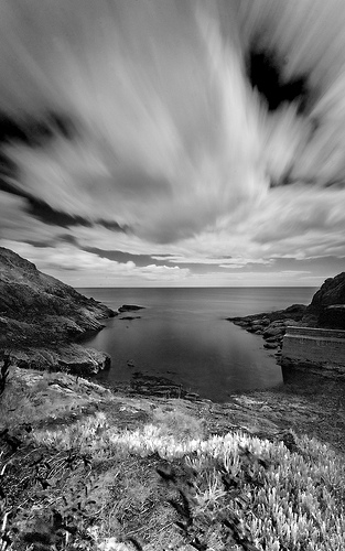 Long exposure black & white landscape photo with movement of clouds blurred