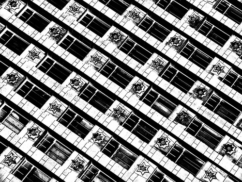 Abstract photo of the repeated pattern of windows on a building