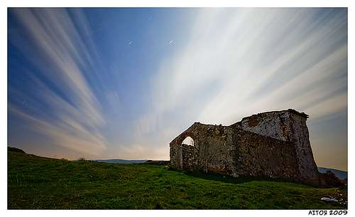 Long exposure of cloud movement over an abandoned building
