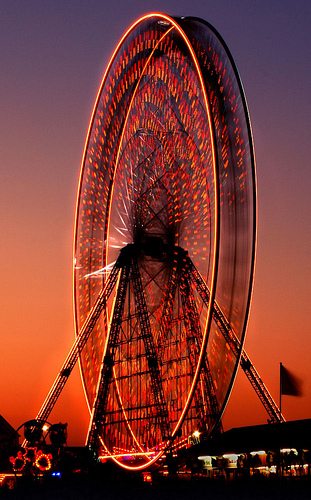 Fatal Attraction! - Moving Ferris Wheel captured at twlight