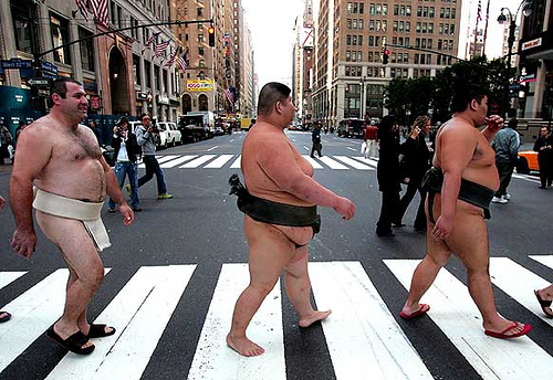Sumo wrestlers crossing the street