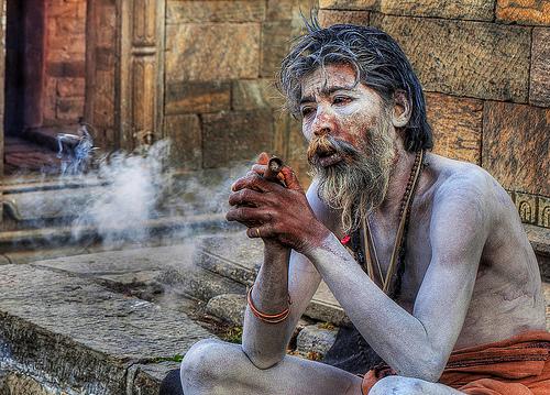 Aghori Contemplating - travel portrait photo
