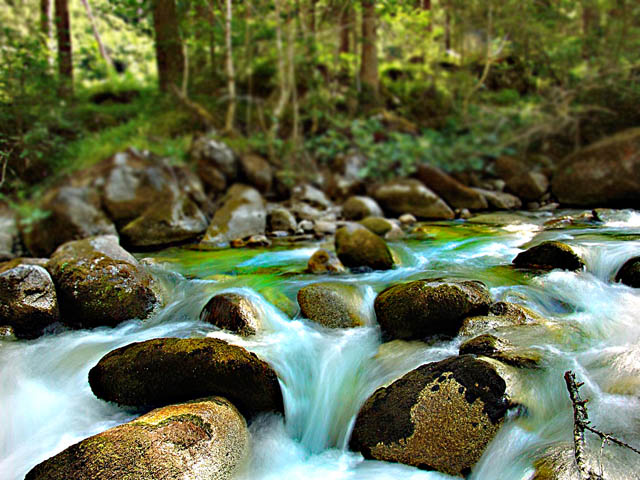 Flowing river long exposure landscape photograph - neutral density filter used to allow for a longer shutter speed