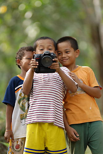 Portrait of children taken standing further back with a telephoto (zoomed in) focal length