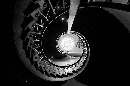 Black & white photo looking up a circular stairway