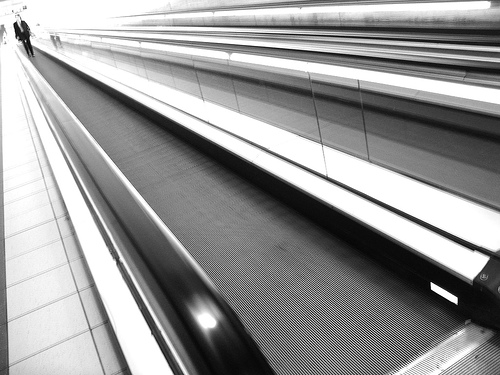 Blakc & white photo of a travelator moving walkway