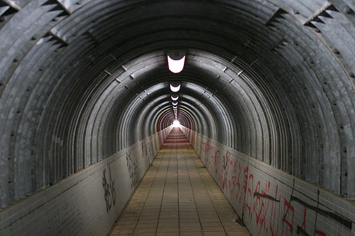 Photo looking along a tunnel using a centered composition