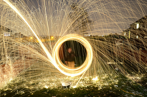Burning steel wool sparks wheel outside