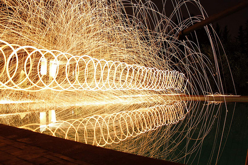 Psychic ray - burning steel wool spun while walking along the edge of a pool