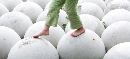Child Walking on White Round Spheres, good white balance