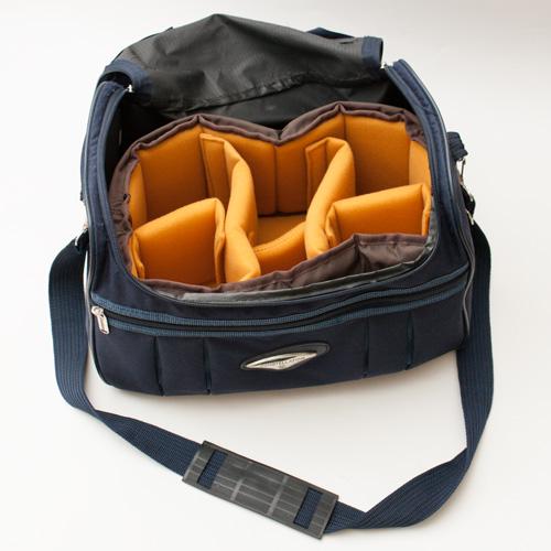 Shoulder bag with a camera bag insert