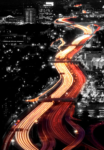 Light trails along the highway selective color photo