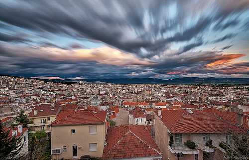 Moving clouds above a town long exposure