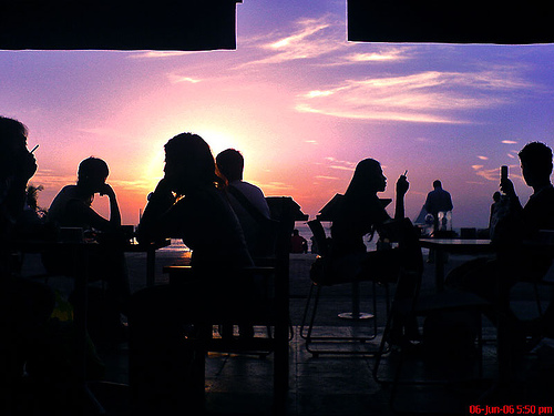 Silhouettes at a cafe at sunset, taken with a phone camera