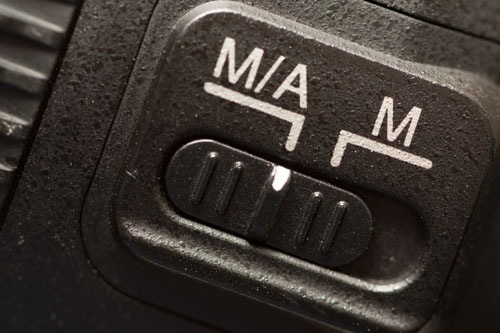 The focus switch on a Nikon lens - Autofocus is labeled as M/A to indicate that manual override is available in autofocus mode