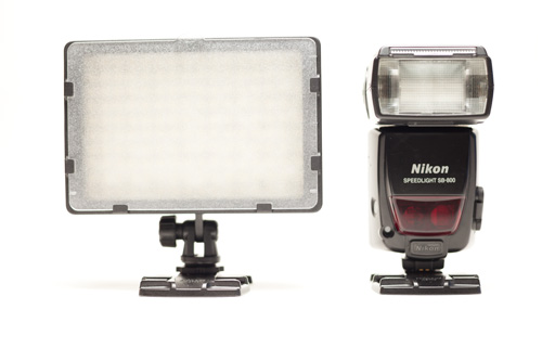 CN-160 LED light panel size compared to a Nikon SB-800 Speedlight hot shoe flash, front view