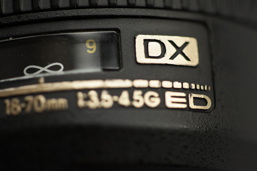 DX designation on a Nikon F mount lens designed for use with cameras featuring an APS-C sized sensor