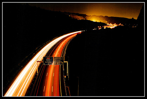 autobahn at night featuring light trails left by car headlights