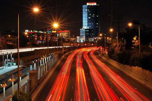 Stream of red light trails left by cars' tail lights