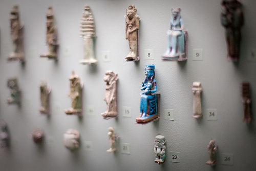 Photo of artifacts in museum, large paerture used to give shallow depth of field and compensate for low light levels