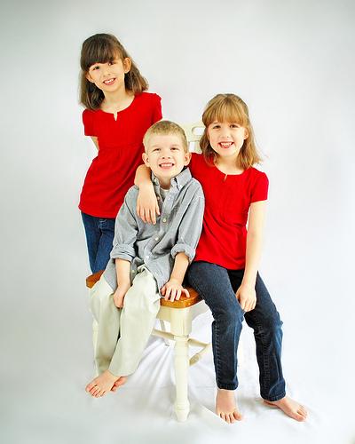 Kids on white - family studio portrait