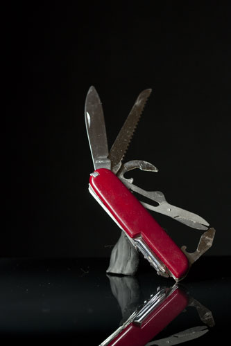 Original photo of penknife titled at an angle with plasticine support visible