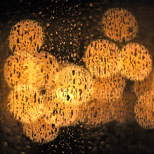 raindrops on the window with out of focus lights in the background