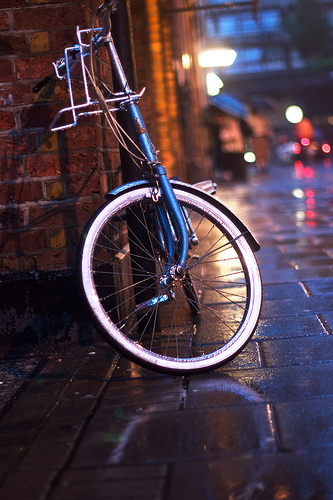 Reflection of bike and lights on wet street