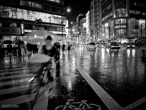 Street photography - wet city streets at night on a rainy evening