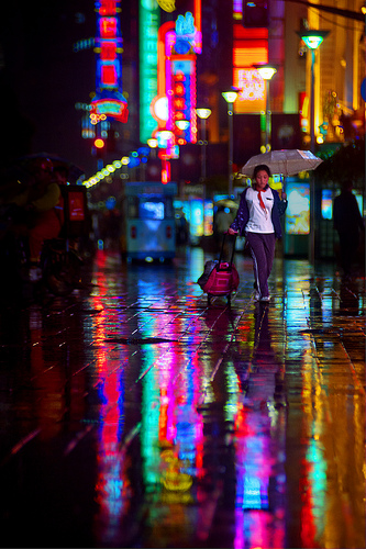 Lost Schoolgirl - city lights reflecting on the wet streets