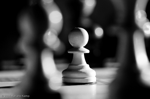 Still life photograph of a pawn on a chess board