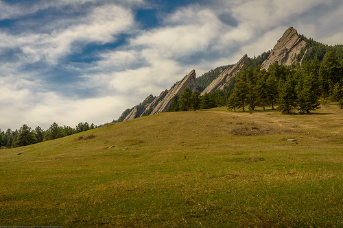 Flat Irons landscape photo captured using an interchangeable lens DSLR camera