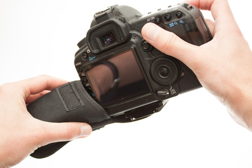 Trying to stuff a DSLR into a padded case designed for a compact camera