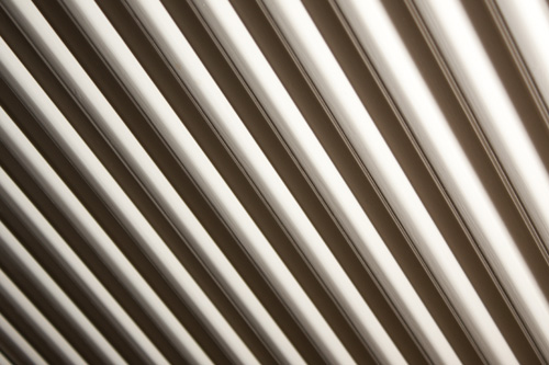 Abstract photo of a radiator using harsh side lighting