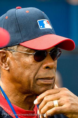Former baseball player portrait photo wearing a baseball cap
