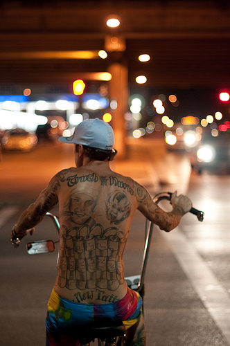 Tattooed Biker - low light photo, capturing an image in light levels like this would be very difficult with most compact cameras