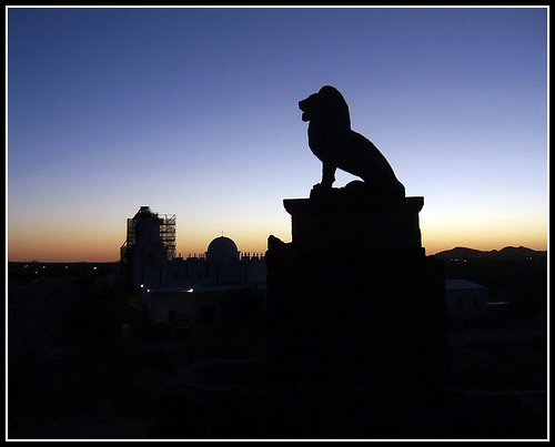 Lion statue silhouette during the blue hour