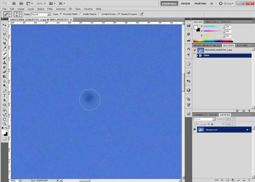 Using the spot healing brush in Photoshop to remove a dust spot
