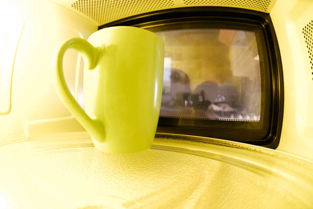 Mug of drink being warmed in the microwave