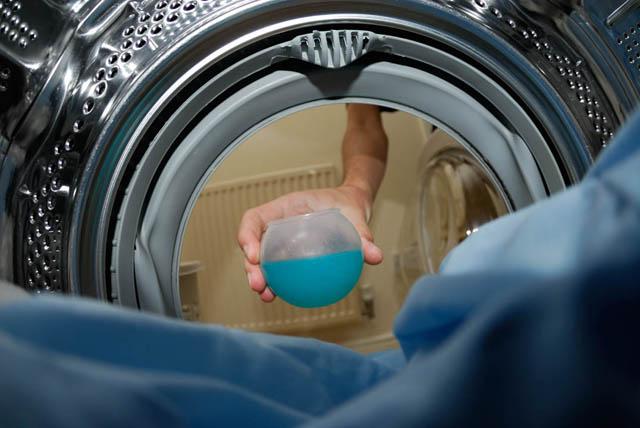 Putting detergent in the washing machine